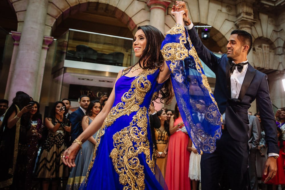 bride and groom entrance London Indian Wedding Photographer